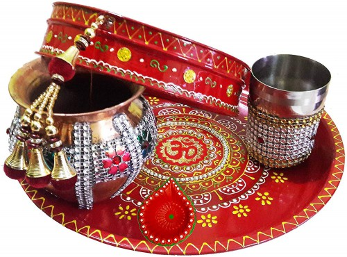 Decorated Colorful Om Pooja Thali Set For Karwachauth Festival https://www.amazon.in/dp/B01LEXFRJU/ref=sspa_dk_detail_4 It is time to celebrate karwa chauth in style. This is reason craftera represents Karwa Chauth thali set for delightful celebration. This Decorated Colorful Om Pooja Thali Set is handmade items that are made of special stone lace and beautiful Stones studded. So, celebrate your karwachauth with our special KarwaChauth thali set. Now the size of this Decorated Pooja Thali-26 cm diameter & width is 3 cm, Decorated Latkan Channi-18 cm diameter & width is 4.5 cm, Decorated Copper Lota-10 cm diameter & length is 10 cm, Decorated Glass -6 cm diameter & length is 8 cm and Decorated Diya- 5 cm diameter & height is 3.5 cm. customized karwa chauth thali set, Karwachauth thali set under 500, Karwachauth thali set with photo